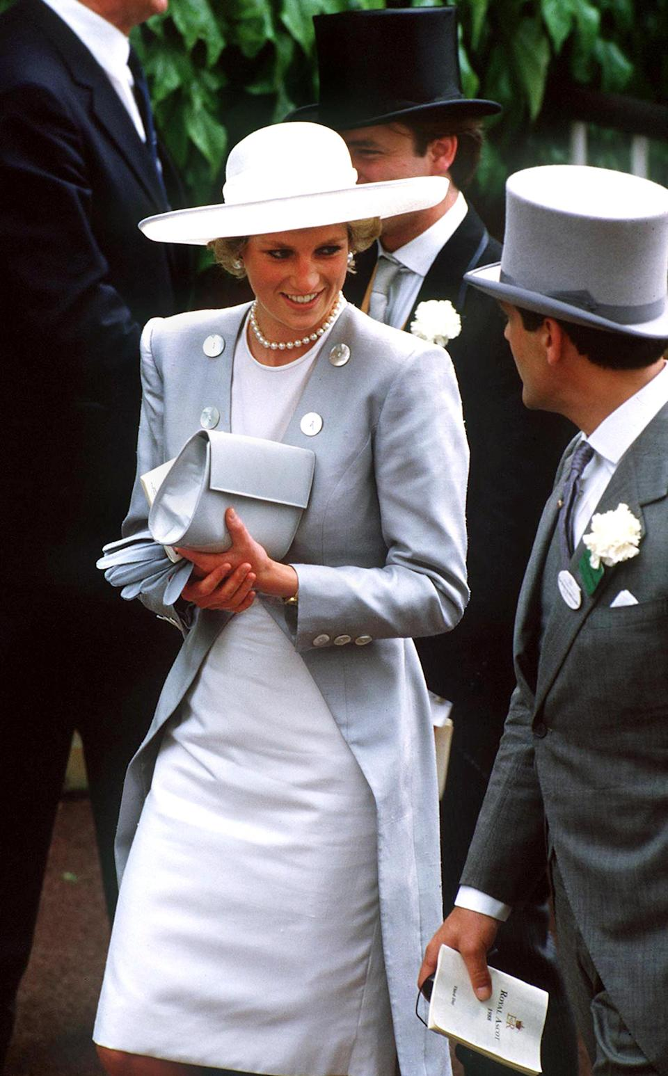<p>For the 1988 races, Princess Diana wore a Catherine Walker suit with a Philip Somerville hat. <em>[Photo: Getty]</em> </p>