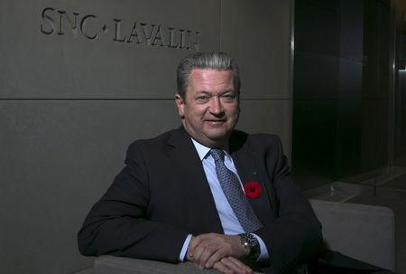 FILE PHOTO:  Neil Bruce, president and CEO of SNC-Lavalin, poses in their head offices in Montreal