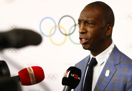 FILE PHOTO: American sprinter Michael Johnson talks to media at the briefing of 2024 Olympic Games candidate cities Paris and Los Angeles ahead of final election of 2024 Olympic host city, in Lausanne, Switzerland July 11, 2017. REUTERS/Pierre Albouy