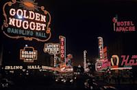 <p>Fremont Street in Las Vegas at night in 1955. The Golden Nugget is a luxury hotel and was the largest casino in the downtown area—it's also the oldest casino still in operation today.</p>