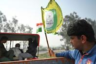 Tractors carrying donations, blasting out music and flying flags in support of the protests go to and from the villages