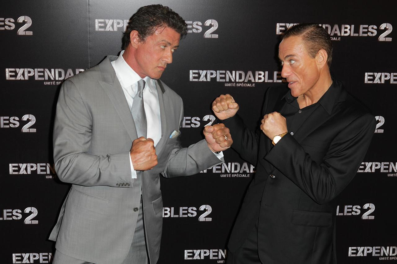 "Sylvester Stallone and Jean Claude Van Damme at the Paris premiere of ""The Expendables 2"" on August 9, 2012."