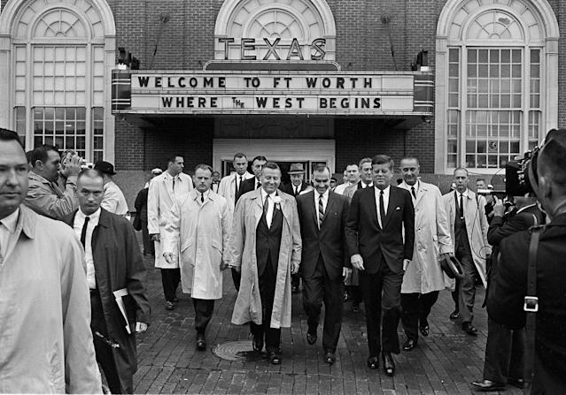 <p>President John F. Kennedy, front, right, exits the Hotel Texas in Fort Worth, at 8:45 a.m., Nov. 22, 1963. He is on his way to greet crowds and make a speech. At right holding hat and wearing raincoat is Vice President Lyndon B. Johnson. (Photo: AP) </p>