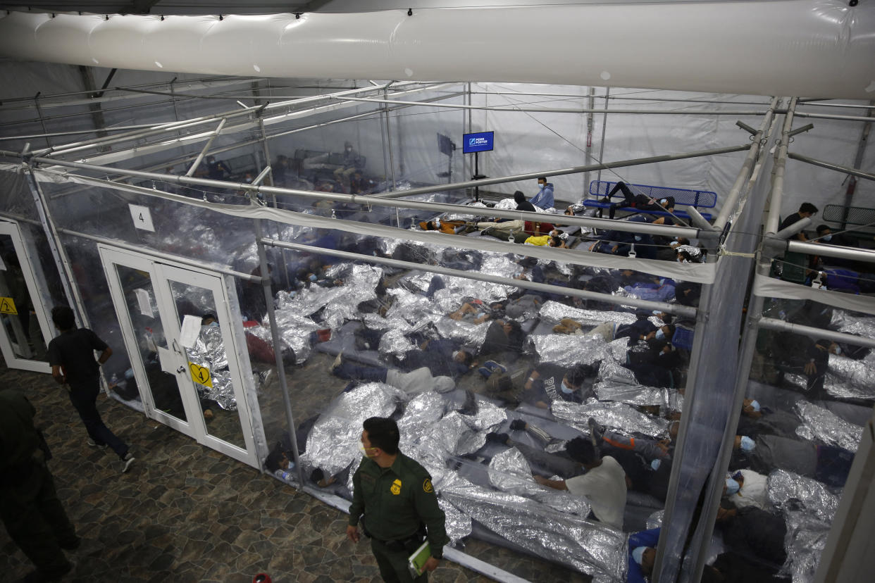 Young minors lie inside a pod at the Donna Department of Homeland Security holding facility, the main detention center for unaccompanied children in the Rio Grande Valley run by the US Customs and Border Protection, (CBP), in Donna, Texas on March 30, 2021. (Dario Lopez-Mills/AFP via Getty Images)