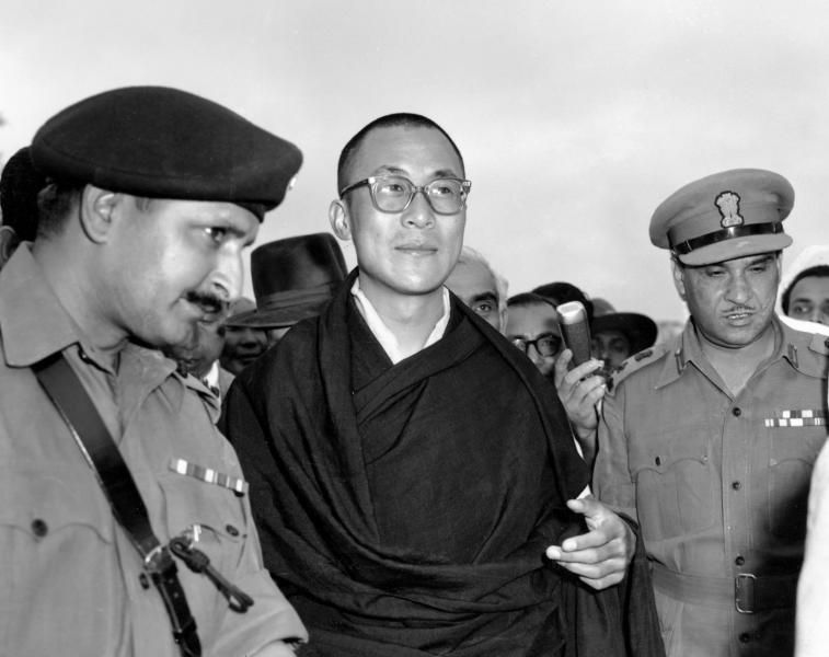 FILE - In this April 18, 1959, file photo, Tibetan spiritual leader the Dalai Lama, center, arrives at Tezpur, Assam in India. Tibetan activists put up posters and hoisted a Tibetan flag in India's capital New Delhi on Sunday, March 10, 2019, to mark the 60th anniversary of 1959 uprising against Chinese rule. (AP Photo, File)