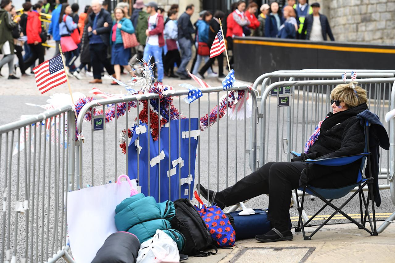 <p>A royal fan from the United States takes her seat days before the wedding [Photo: Getty] </p>