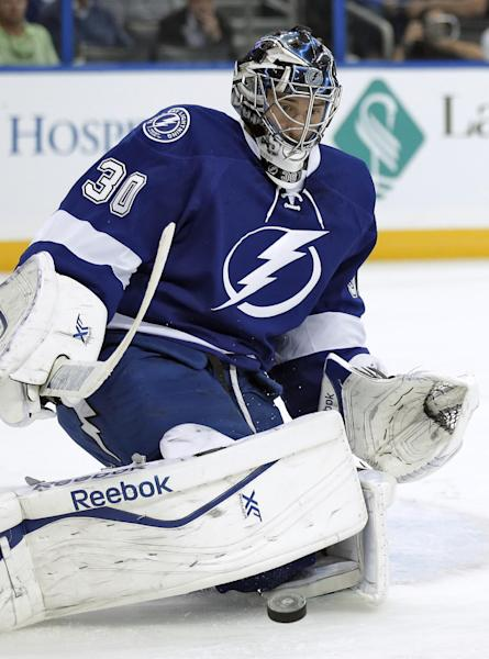 Tampa Bay Lightning goalie Ben Bishop stops a shot by the Florida Panthers during the first period of an NHL hockey game Thursday, Oct. 10, 2013, in Tampa, Fla. (AP Photo/Chris O'Meara)