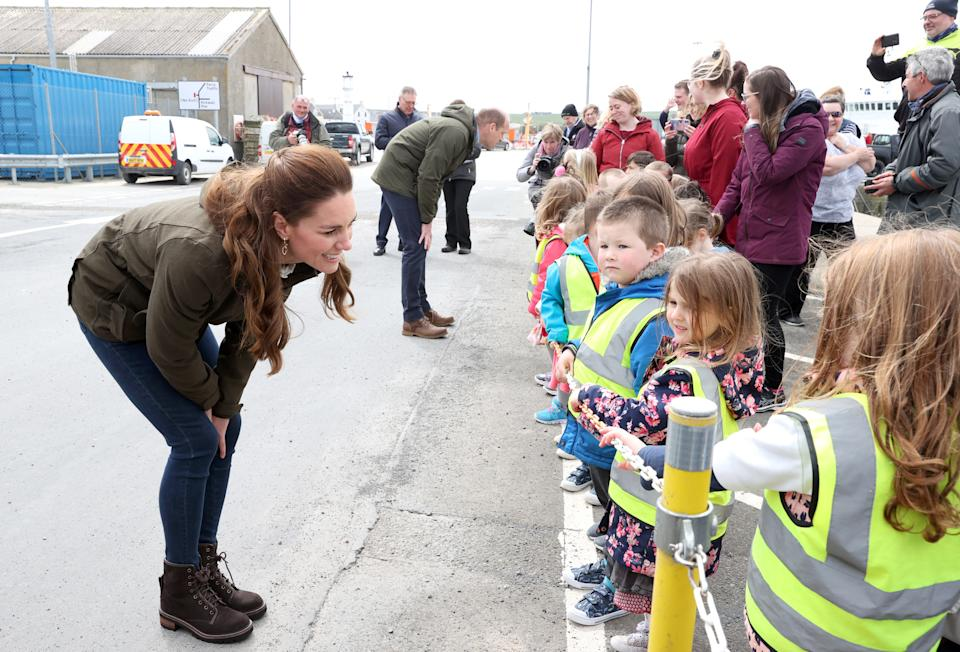 The Duchess of Cambridge spoke to school children as they visited the European Marine Energy Centre during their royal tour of Scotland, which saw the duchess wear a Brora blouse, denim jeans, See By Chloé boots and a weatherproof jacket from Seeland. (Getty Images)