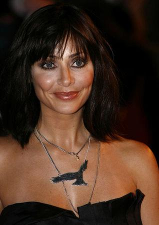 FILE PHOTO: Singer Natalie Imbruglia poses for photographers as she arrives for the Brit Awards