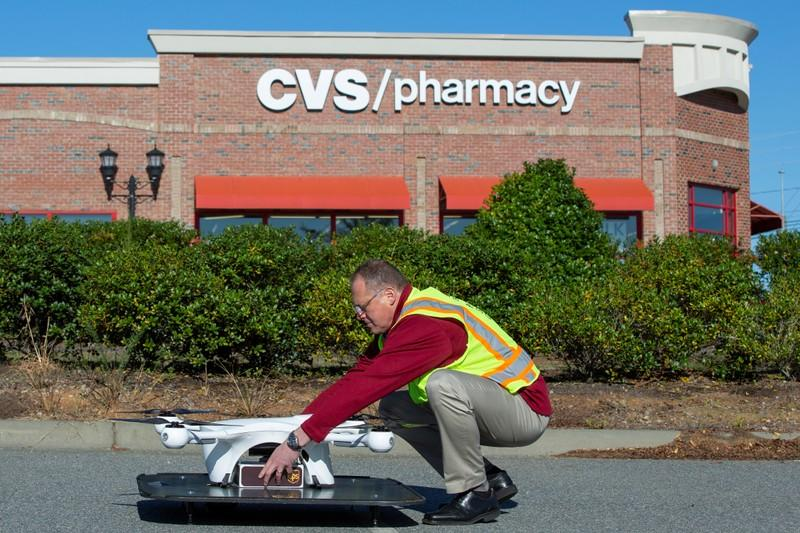 A UPS Flight Forward technician places a package onto a drone during the first residential delivery of prescription medication for CVS in Cary