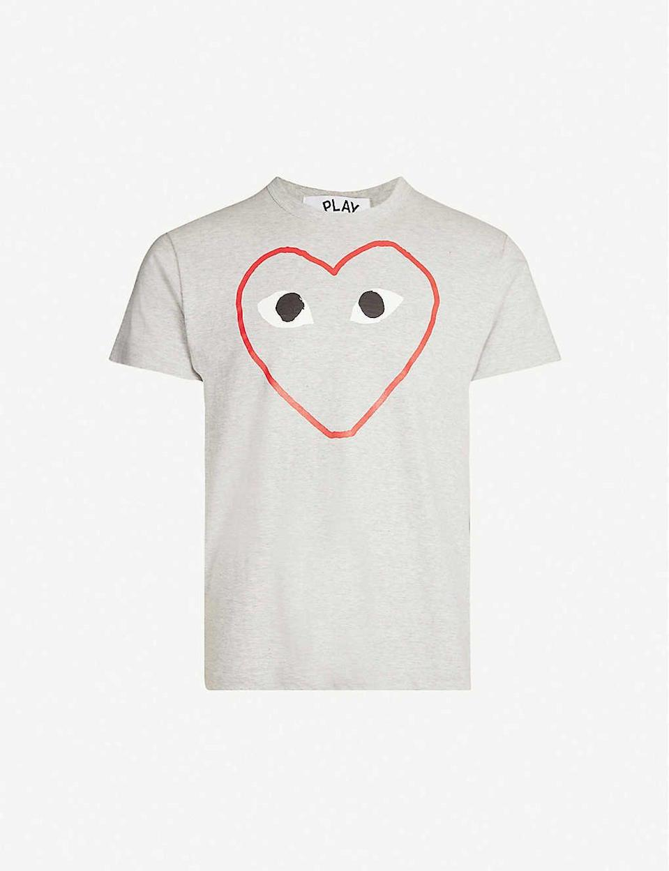 """<p><strong>Comme Des Garcons Play</strong></p><p>selfridges.com.us</p><p><strong>$121.00</strong></p><p><a href=""""https://go.redirectingat.com?id=74968X1596630&url=https%3A%2F%2Fwww.selfridges.com%2FUS%2Fen%2Fcat%2Fcomme-des-garcons-play-cdg-empty-heart-tee_1124-2000022-P1T266&sref=https%3A%2F%2Fwww.seventeen.com%2Flife%2Ffriends-family%2Fg1088%2Fholiday-gifts-for-dad%2F"""" rel=""""nofollow noopener"""" target=""""_blank"""" data-ylk=""""slk:Shop Now"""" class=""""link rapid-noclick-resp"""">Shop Now</a></p><p>10/10 would steal from Dad's closet. </p>"""