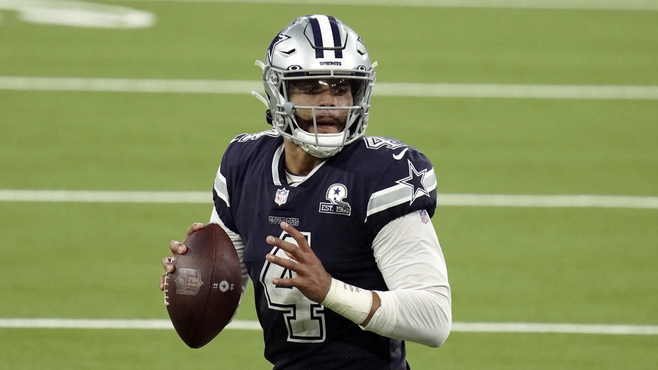 Dallas Cowboys quarterback Dak Prescott (4) looks to throw during the second half of an NFL football game against the Los Angeles Rams Sunday, Sept. 13, 2020, in Inglewood, Calif. (AP Photo/Jae C. Hong)