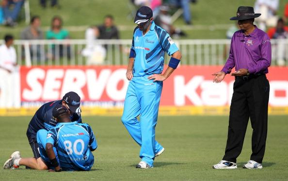 DURBAN, SOUTH AFRICA - OCTOBER 17:  Martin van Jaarsveld checks on team-mate Ethy Mbalathi of Nashua Titans during the Karbonn Smart CLT20 match between Nashua Titans and Auckland Aces at Sahara Stadium Kingsmead on October 17, 2012 in Durban, South Africa.  (Photo by Anesh Debiky/Gallo Images/Getty Images)