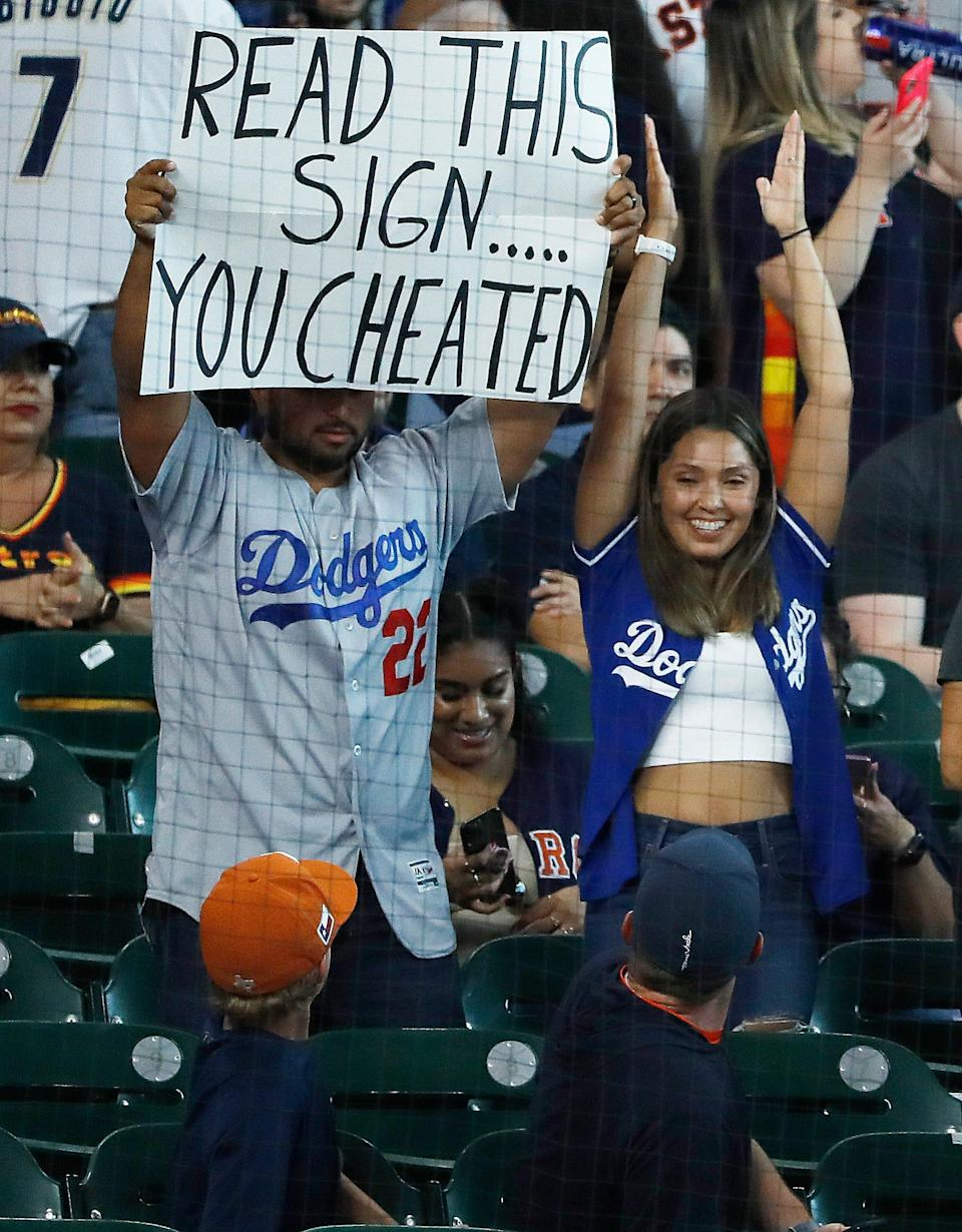 Los Angeles Dodgers fans taunt the Houston Astros before a game, Tuesday, May 25, 2021 at Minute Maid Park in Houston.
