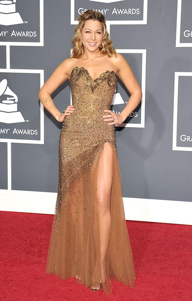 """Colbie Caillat  Grade: C   Jason's """"Lucky"""" collaborator let us down in one of Lebanese designer Nicholas Gibran's most garish gowns. John Shearer/<a href=""""http://www.wireimage.com"""" target=""""new"""">WireImage.com</a> - January 31, 2010"""
