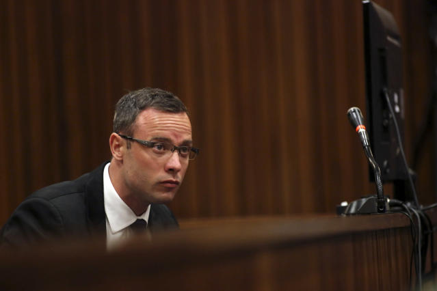 Oscar Pistorius listens to cross questioning in court of his murder trial in Pretoria, South Africa, Monday, March 17, 2014. Pistorius is on trial for the murder of his girlfriend, Reeva Steenkamp, on Valentine's Day, 2013. (AP Photo/Siphiwe Sibeko, Pool)