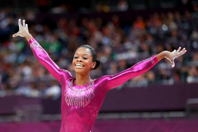 Gabrielle Douglas of the United States reacts after he competes on the balance beam in the Artistic Gymnastics Women's Individual All-Around final on Day 6 of the London 2012 Olympic Games at North Greenwich Arena on August 2, 2012 in London, England.  (Photo by Streeter Lecka/Getty Images)