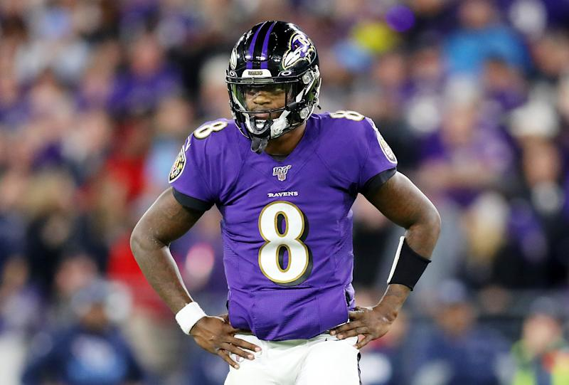 BALTIMORE, MARYLAND - JANUARY 11: Lamar Jackson #8 of the Baltimore Ravens reacts during the first half against the Tennessee Titans in the AFC Divisional Playoff game at M&T Bank Stadium on January 11, 2020 in Baltimore, Maryland. (Photo by Maddie Meyer/Getty Images)
