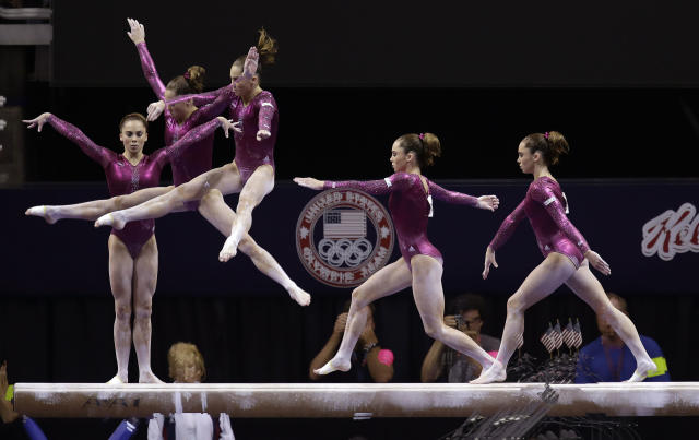 In this multiple exposure photo shot at one quarter of a second intervals, McKayla Maroney competes on the balance beam during the final round of the women's Olympic gymnastics trials, Sunday, July 1, 2012, in San Jose, Calif. Maroney was named to the U.S. Olympic gymnastics team. (AP Photo/Julie Jacobson)
