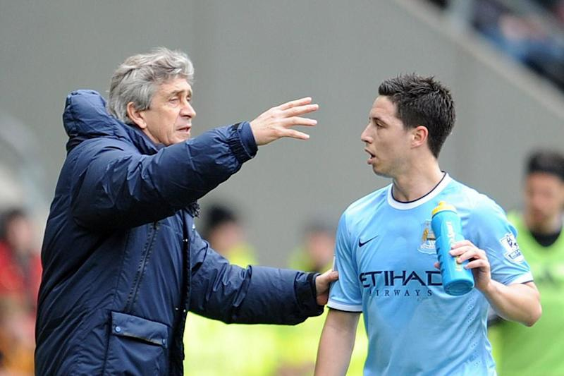 At the double: Nasri won the Premier League and league Cup under Pellegrini (Getty Images)