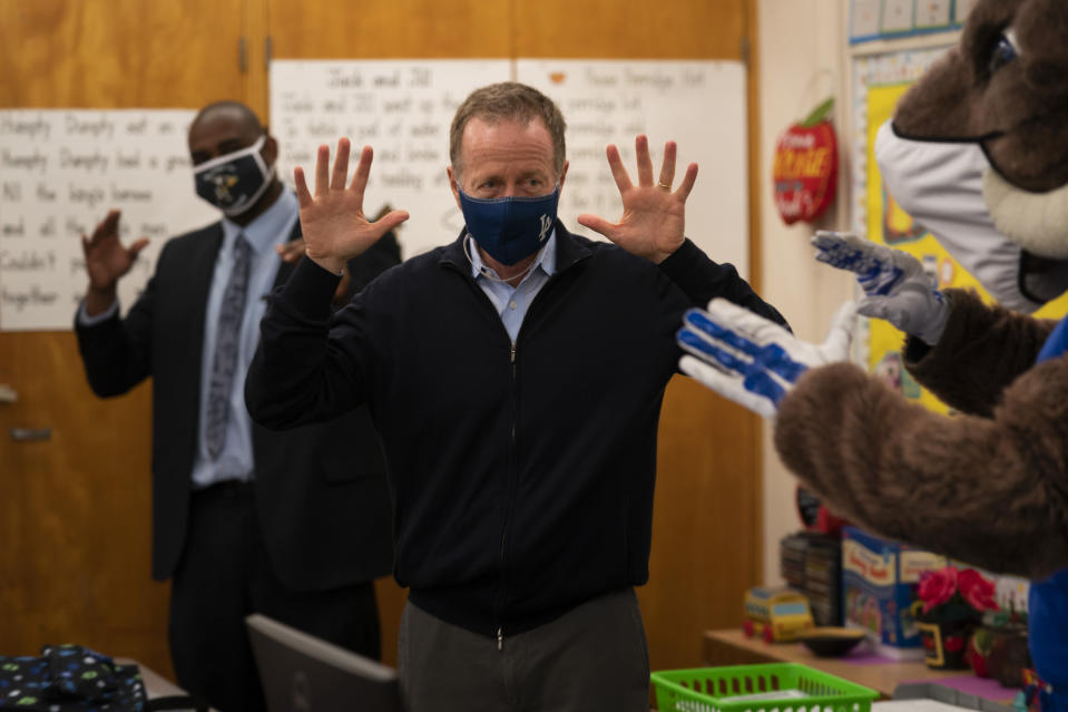 Los Angeles Unified School District Superintendent Austin Beutner participates in a classroom activity on the first day of in-person learning at Heliotrope Avenue Elementary School in Maywood, Calif., Tuesday, April 13, 2021. More than a year after the pandemic forced all of California's schools to close classroom doors, some of the state's largest school districts are slowly beginning to reopen this week for in-person instruction. (AP Photo/Jae C. Hong)