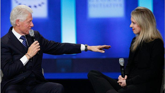 On stage with former US President Bill Clinton in 2015