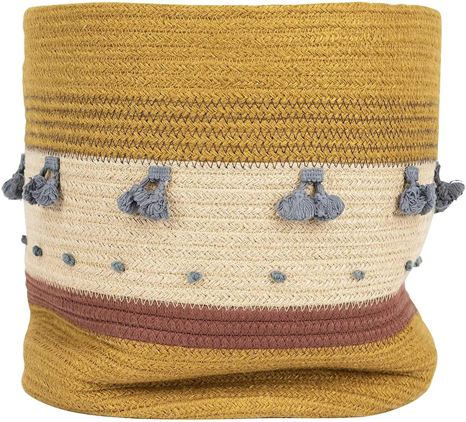 """<h2>Creative Co-op Jute Rope Basket</h2><br>This multicolored woven vessel will make anything from toys to excess linens to plants look bohemian and chic.<br><br><strong>Creative Co-Op</strong> Jute Rope Basket, $, available at <a href=""""https://amazon.com/Creative-Co-op-Mustard-Stripes-Non-Food/dp/B07VDT3WM6"""" rel=""""nofollow noopener"""" target=""""_blank"""" data-ylk=""""slk:Amazon"""" class=""""link rapid-noclick-resp"""">Amazon</a>"""