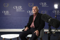 """Valentin Inzko, the outgoing head of Bosnia's Office of the High Representative, or OHR, listens to a question during an interview with the Associated Press, in the capital Sarajevo, Bosnia, Monday, July 26, 2021. Bosnia's outgoing top international overseer has urged the Western powers to urgently adopt a new approach to the politically fragmented post-war country to stop its """"not sincere"""" nativist leaders from turning it into a deserted wasteland. (AP Photo)"""