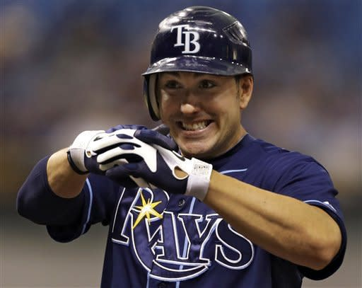 Tampa Bay Rays' Matt Joyce reacts with a hand gesture to teammates after his third inning single off Kansas City Royals starting pitcher Luis Mendoza during a baseball game Wednesday, Aug. 22, 2012 in St. Petersburg, Fla. (AP Photo/Chris O'Meara)