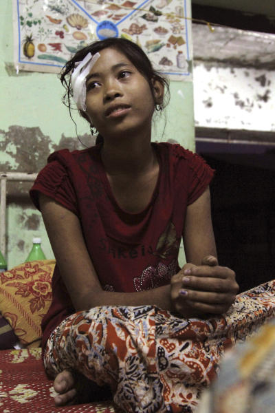 In this Oct. 25, 2012 photo, a Rakhine refugee receives medical treatment at Kyauktaw hospital in Kyauktaw, Rakhine State, western Myanmar. At least 56 people have been killed and 1,900 homes destroyed in renewed ethnic violence between the Buddhist Rakhine and Muslim Rohingya communities in western Myanmar as the government warned perpetrators and the international community appealed for calm. (AP Photo/Khin Maung Win)