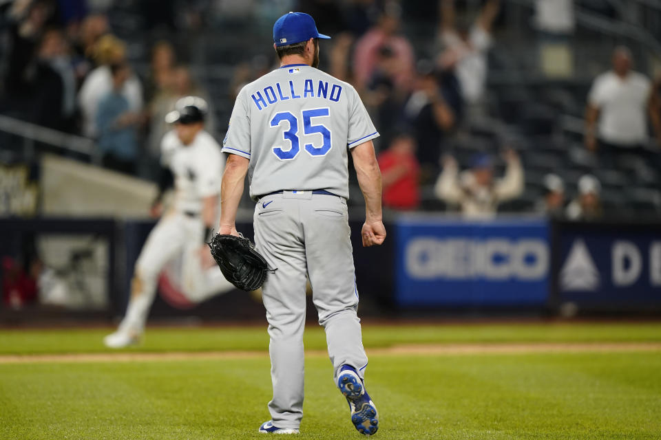 Kansas City Royals relief pitcher Greg Holland (35) looks to the outfield as New York Yankees pinch runner Tyler Wade, left, heads home to score after Luke Voit's game-winning RBI single in the bottom of the ninth inning of a baseball game, Wednesday, June 23, 2021, at Yankee Stadium in New York. (AP Photo/Kathy Willens)