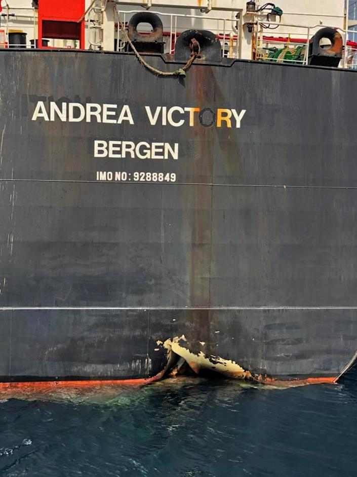 """A picture taken on May 13, 2019 off the coast of the Gulf emirate of Fujairah shows Norwegian oil tanker Andrea Victory, one of the four tankers damaged in alleged """"sabotage attacks"""" in the Gulf the previous day.Saudi Arabia said two of its oil tankers were damaged in the mysterious """"sabotage attacks"""" as tensions soared in a region already shaken by a standoff between the United States and Iran. (AFP Photo/HANDOUT)"""