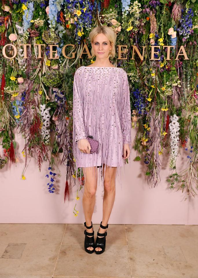 <p>Poppy Delevingne donned a heavily-embroidered pink dress with a co-ordinating clutch. <em>[Photo: Getty]</em> </p>