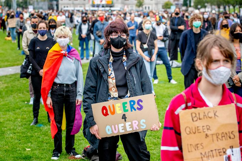 Protesters wore face coverings at a demonstration held at Museumplein against anti-black gay and Trans violence - getty