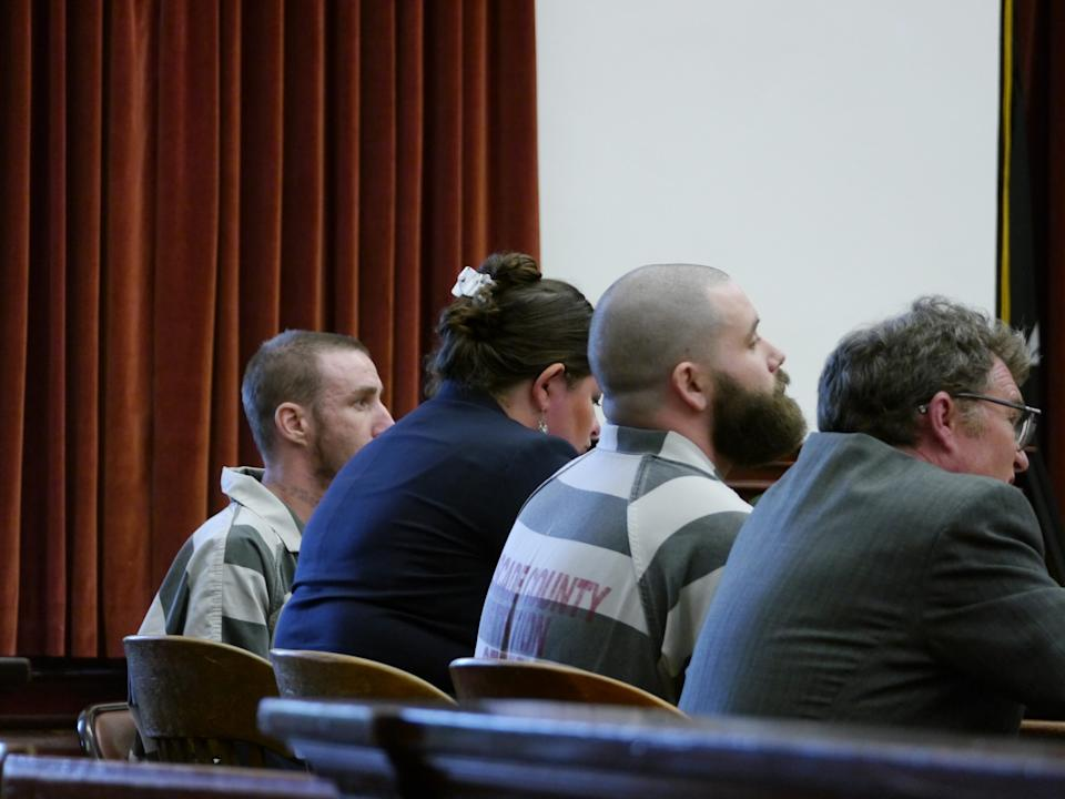 From left, Troy Allan Nelson, attorney Claire Lettow, Ryan Patrick Morris and attorney Mark Frisbie listen as Judge Greg Pinski addresses the concept of stolen valor Friday in Cascade County, Mont.