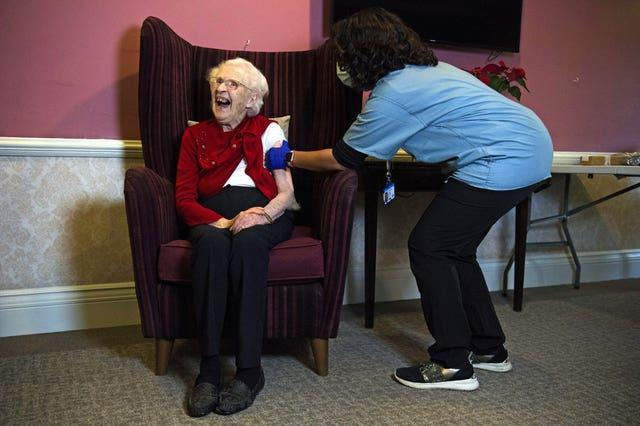 Ellen Prosser, 100, receives the Oxford/AstraZeneca COVID-19 vaccine from Dr Nikki Kanani (Kirsty O'Connor/PA)