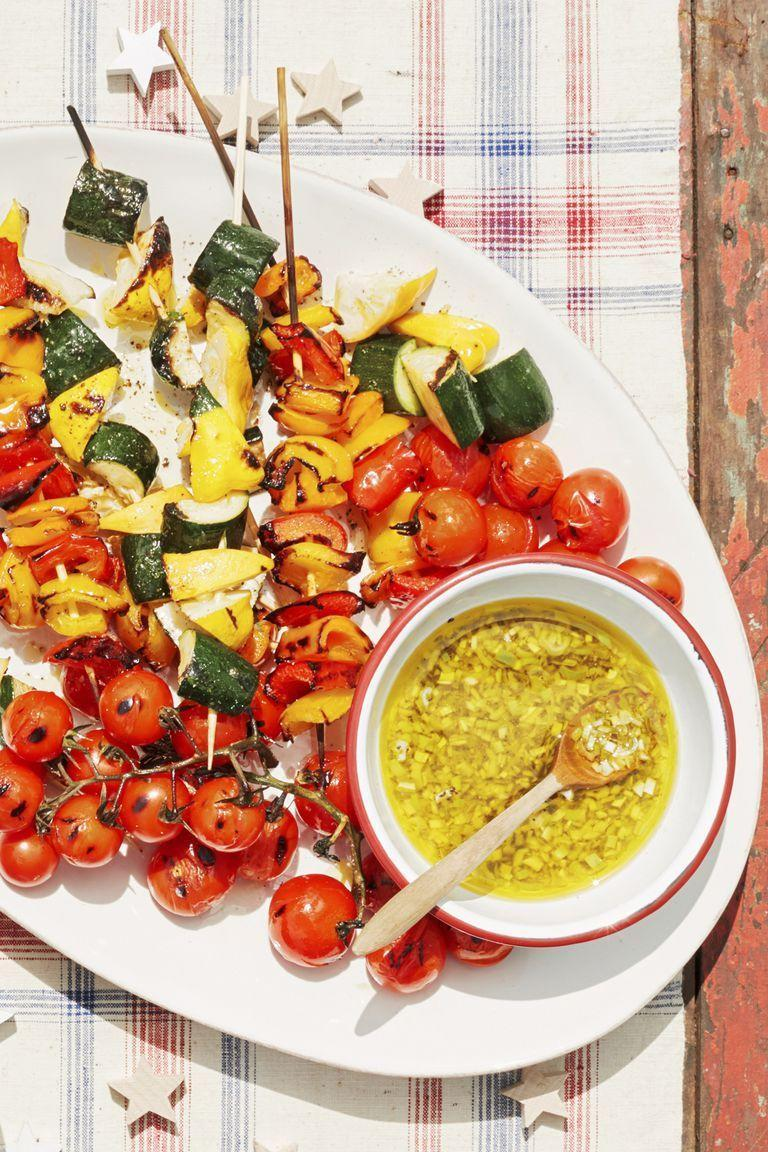 """<p>Just because you're going plant-based doesn't mean you can't break out the grill. Fresh mint takes these charred vegetables to the next level.</p><p><strong><a href=""""https://www.countryliving.com/food-drinks/a21347703/vegetable-kebabs-with-lemon-scallion-vinaigrette-recipe/"""" rel=""""nofollow noopener"""" target=""""_blank"""" data-ylk=""""slk:Get the recipe"""" class=""""link rapid-noclick-resp"""">Get the recipe</a>.</strong></p><p><strong><a class=""""link rapid-noclick-resp"""" href=""""https://www.amazon.com/Weber-741001-Original-22-Inch-Charcoal/dp/B00004RALU/?tag=syn-yahoo-20&ascsubtag=%5Bartid%7C10050.g.32934702%5Bsrc%7Cyahoo-us"""" rel=""""nofollow noopener"""" target=""""_blank"""" data-ylk=""""slk:SHOP GRILLS"""">SHOP GRILLS</a><br></strong></p>"""