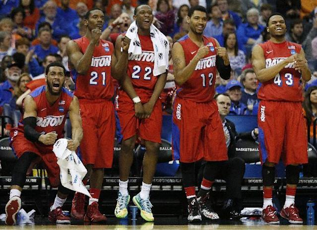 Dayton players celebrate a three-point shot against Stanford during the second half in a regional semifinal game at the NCAA college basketball tournament, Thursday, March 27, 2014, in Memphis, Tenn. Dayton won 82-72. (AP Photo/John Bazemore)