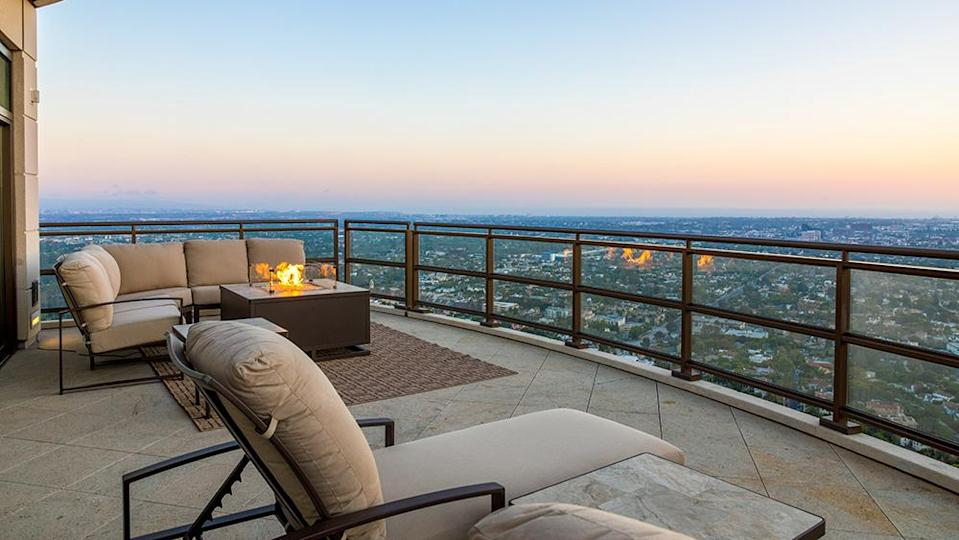 A terrace with firepit - Credit: Photo: Anthony Barcelo/Compass