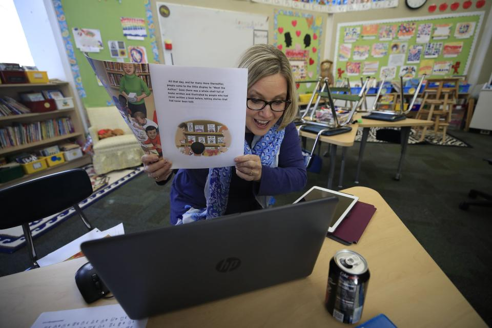 A second grade teacher teaches online in her empty classroom on April 15, 2020 in Goshen, Kentucky. (PHOTO: Andy Lyons/Getty Images)