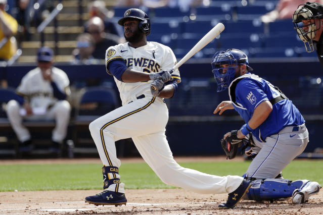 Milwaukee Brewers' Lorenzo Cain grounds out while batting during the first inning of a spring training baseball game against the Kansas City Royals, Thursday, Feb. 27, 2020, in Phoenix. (AP Photo/Gregory Bull)