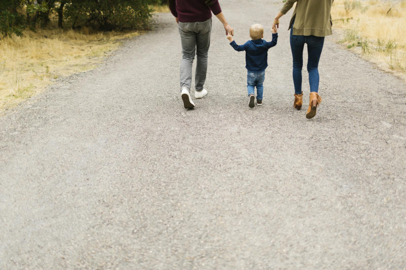Family walking on rural road together