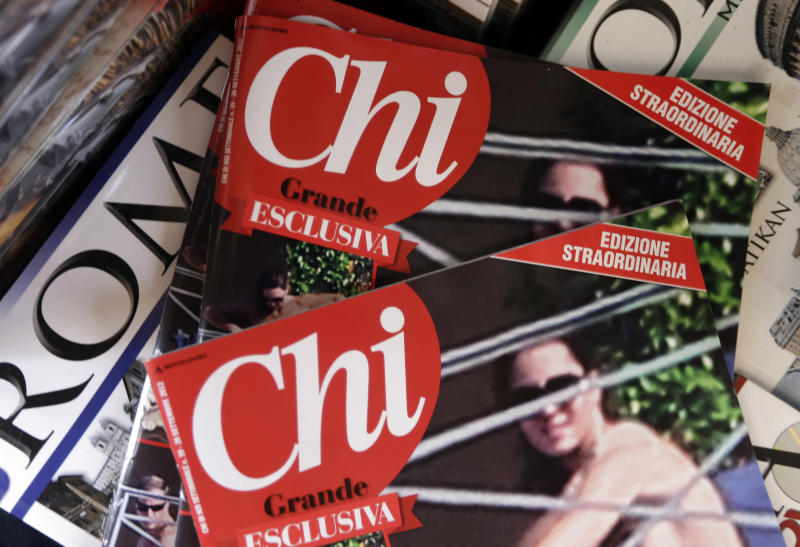 Copies of the Italian magazine Chi are displayed at a newstands in Rome, Monday, Sept. 17, 2012. An Italian gossip magazine owned by former Premier Silvio Berlusconi published a 26-page spread of topless photos of Prince William's wife Kate on Monday despite legal action in France against the French magazine that published them first. Chi hit newsstands on Monday, featuring a montage of photos taken while the Duke and Duchess of Cambridge were on vacation at a relative's home in the south of France last month. They included the 14 pictures published by the popular French magazine Closer, which like Chi is owned by Berlusconi's Mondadori publishing house. (AP Photo/Alessandra Tarantino)