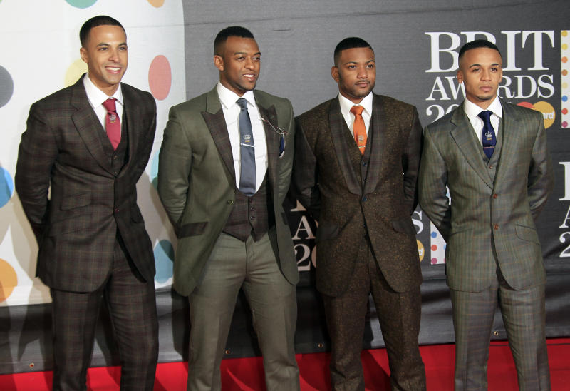 From left, Marvin Humes, Oritse Williams, Jonathan 'JB' Gill and Aston Merrygold of British band JLS seen arriving at the BRIT Awards 2013 at the o2 Arena in London on Wednesday, Feb. 20, 2013. (Photo by Joel Ryan/Invision/AP)