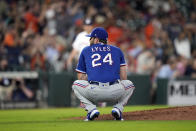 Texas Rangers starting pitcher Jordan Lyles (24) reacts after giving up a home run to Houston Astros' Myles Straw during the fourth inning of a baseball game Wednesday, June 16, 2021, in Houston. (AP Photo/David J. Phillip)