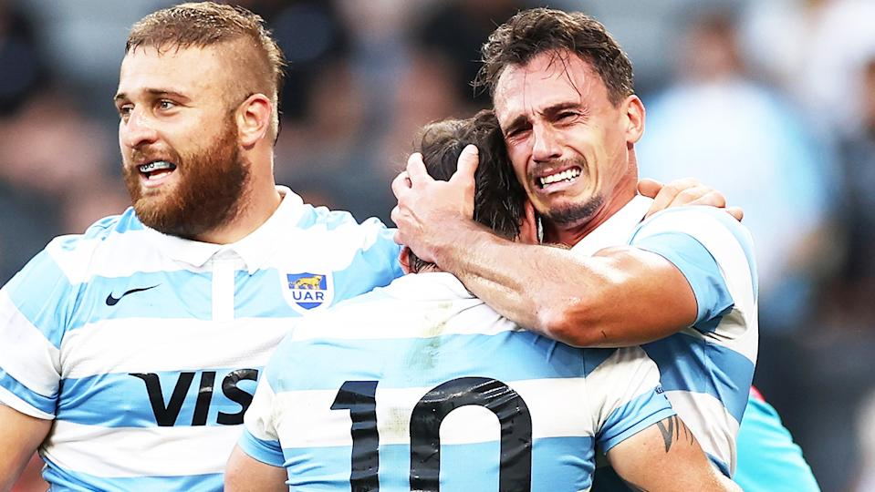 Juan Imhoff cries as he hugs his teammate after winning the 2020 Tri-Nations rugby match.