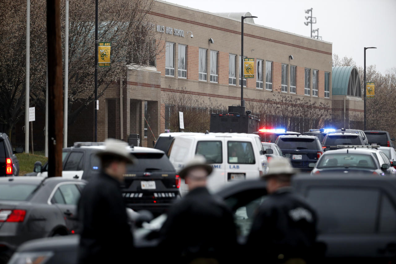 "Deputies and federal agents converge on Great Mills High School, the scene of a shooting, Tuesday morning, March 20, 2018 in Great Mills, Md. The shooting left at least three people injured including the shooter. Authorities said the situation is ""contained."" (AP Photo/Alex Brandon )"