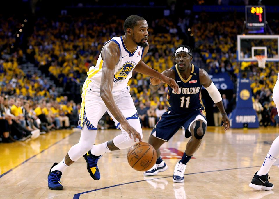 Apr 28, 2018; Oakland, CA, USA; Golden State Warriors forward Kevin Durant (35) dribbles past New Orleans Pelicans guard Jrue Holiday (11) in the third quarter in game one of the second round of the 2018 NBA Playoffs at Oracle Arena. Mandatory Credit: Cary Edmondson-USA TODAY Sports ORG XMIT: USATSI-381753 ORIG FILE ID:  20180428_lbm_se9_217.JPG