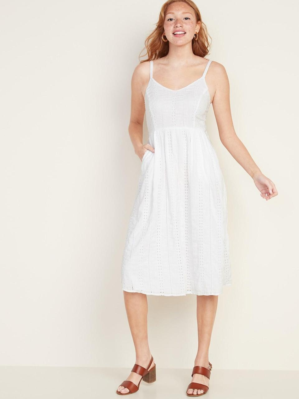 <p>This white <span>Old Navy Fit &amp; Flare Eyelet Cami Midi Dress</span> ($35, originally $45) is so pretty, and it has pockets!</p>