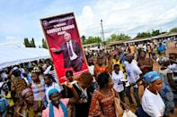 The poster reads 'President Laurent Gbagbo arrives for a true reconciliation of Ivorians', but critics are wary